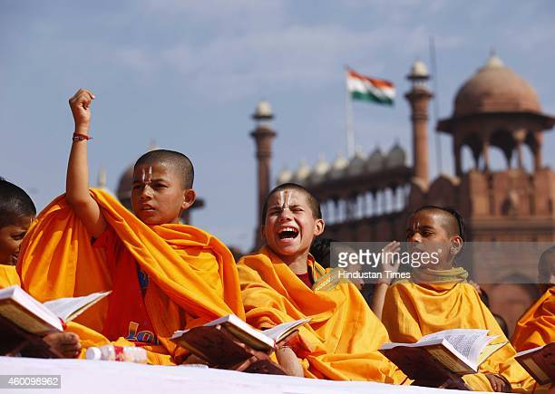 Students reciting Bhagavad Gita to mark the celebration of 5151 years of the Bhagavad Gita at Red Fort Ground on December 7 2014 in New Delhi India...