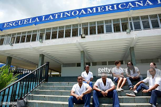 Students relax on a set of stairs on the campus of the Latin American Medical School in Havana Cuba on Tuesday June 9 2015 Cuba plans to invest 50...