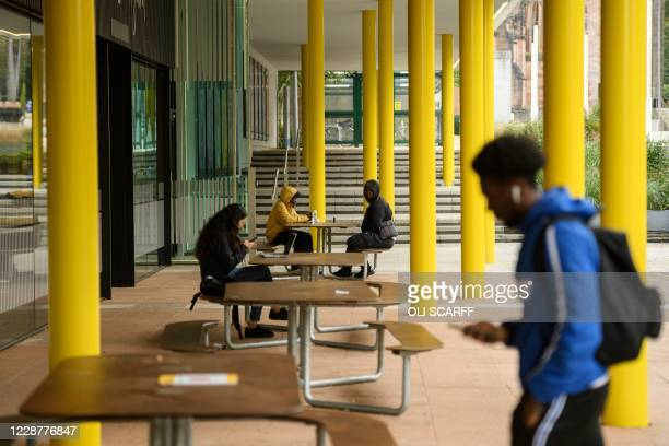 Students relax outside Coventry University campus buildings at the beginning of the new academic year, at Coventry University, in Coventry, central...