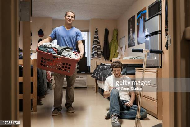 Students relaxing in dorm room