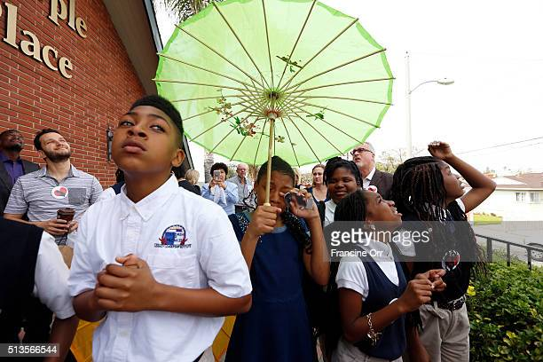 Students release balloons and then take part in the Second Line/ Processional to the main campus the during a ceremony at Children of Promise...