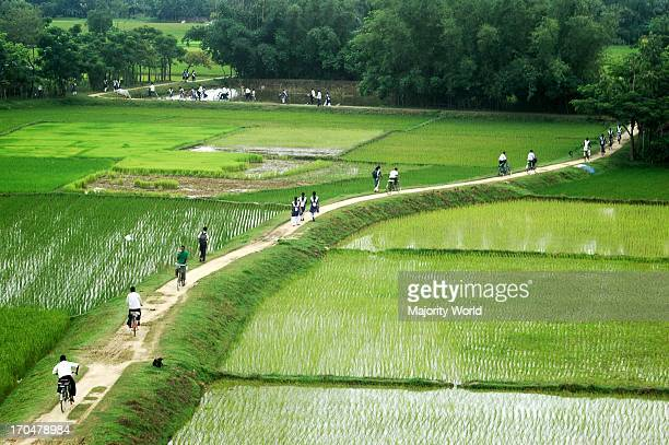 Students return home from school on bicycles a common mode of transportation in the rural parts of Bangladesh Haluaghat Mymensingh Bangladesh August...