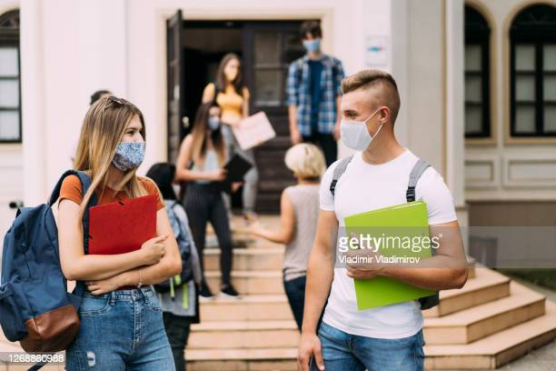 students return to school in coronavirus conditions - schoolboy stock pictures, royalty-free photos & images