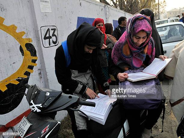 Students revise for the last time before entering exam centre as class 12 state board exams started in Kashmir amidst tight security on November 14...