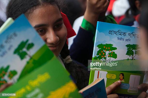 Students rise up textbook during the quotTextbook Festival Dayquot in Dhaka Student celebrated the Textbook Festival on the new year's day in...