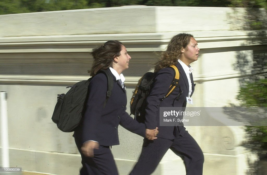 Students run from the U.S. Capitol after the announcement of evacuation.