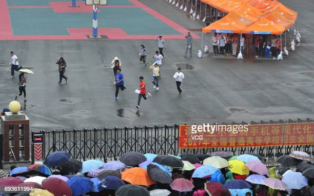 Students run out of exam room after a test of national college entrance examination at Changchun No 103 Middle School on June 7 2017 in Changchun...