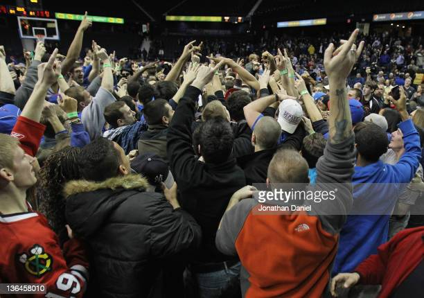 Students rush the court after the DePaul Blue Demons beat the Pittsburgh Panthers at Allstate Arena on January 5 2012 in Rosemont Illinois DePaul...