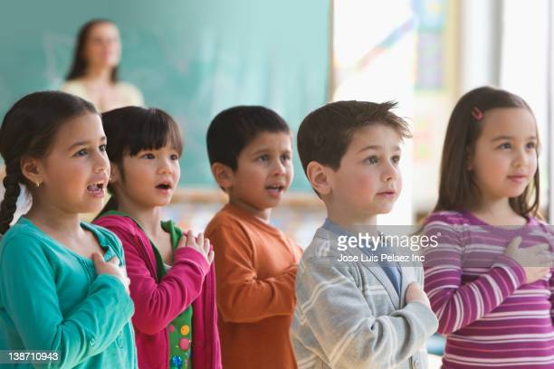 Students saying the Pledge of Allegiance in classroom