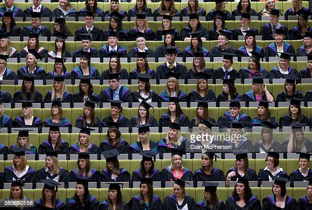 Students seated in rows awaiting the confirmation of their graduation at a ceremony at Edge Hill University Ormskirk Lancashire Edge Hill University...