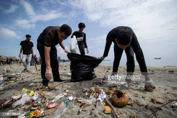 VILLAGE LHOKSEUMAWE ACEH INDONESIA Students seen cleaning up plastic waste that pollutes the beach in Ujong Blang Village Lhokseumawe Aceh province...