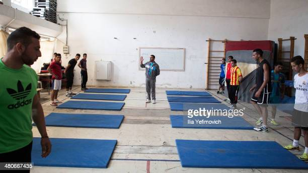 Students seen practising and work out at the Gymnastics room at Al Quds University on March 24 2014 in AbuDis West Bank Al Quds university is the...
