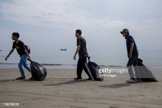 VILLAGE LHOKSEUMAWE ACEH INDONESIA Students seen with sacks of plastic waste during a clean up in Ujong Blang Village Lhokseumawe Aceh province...