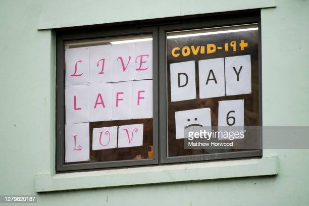 Students self isolating at Talybont South halls of residence at Cardiff University display messages in their window on October 12, 2020 in Cardiff,...