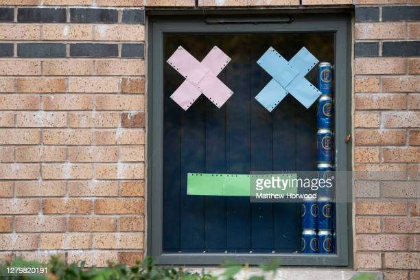 Students self isolating at Talybont South halls of residence at Cardiff University display messages and cans of Fosters beer in their window on...