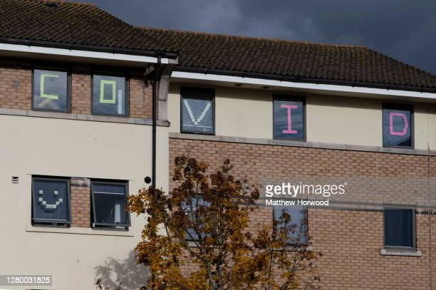 Students self isolating at Talybont South halls of residence at Cardiff University display messages in their window on October 13, 2020 in Cardiff,...