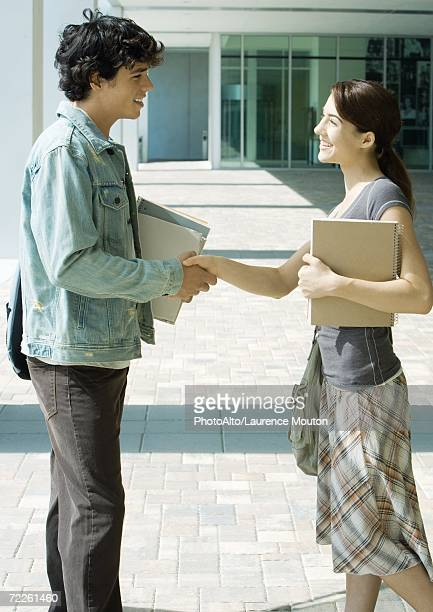 Students shaking hands on campus