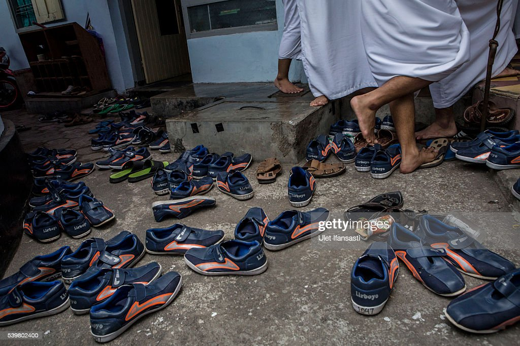 Students shoes are seen as they prepare to perform friday prayers at the islamic boarding school Lirboyo during the holy month of Ramadan on June 10, 2016 in Kediri, East Java, Indonesia. The Islamic boarding school, Lirboyo, was founded by KH Abdul Karim in 1910, and known to be one of the largest traditional 'Pesantren' in Indonesia, with around 17,000 students in Kediri, East Java. Students at the Pesantren, also known as 'Santri', are separated from their families and spend their days studying Islamic scriptures, reading the Quran and learning Arabic in addition to other activities which begins with the morning prayer at 4am till midnight.