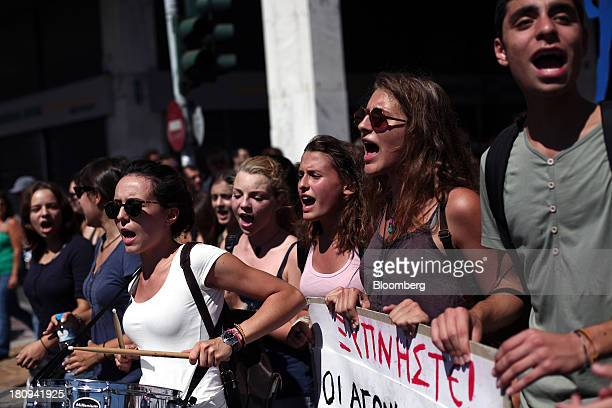 Students shout antigovernment slogans during a demonstration to mark the start of a 48hour strike by Greece's biggest publicsector union ADEDY in...