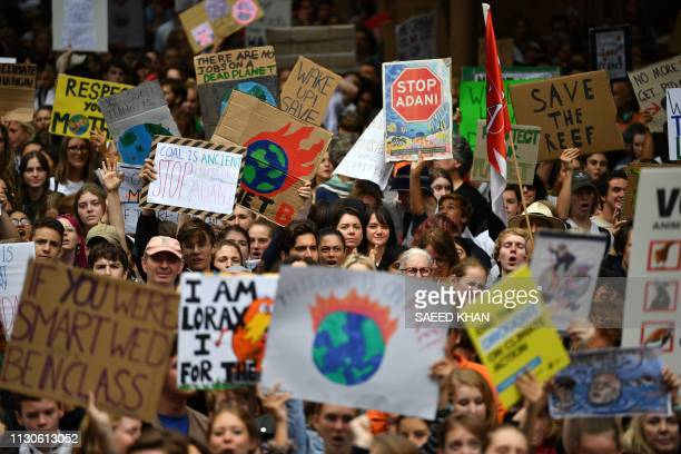 Students shout slogans as they march in a strike and protest by students highlighting inadequate progress to address climate change in Sydney on...
