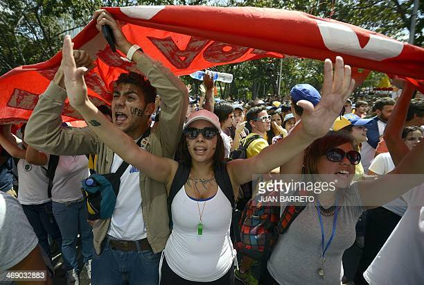 Students shout slogans during an opposition demo against the government of Venezuelan President Nicolas Maduro in Caracas on February 12 2014...