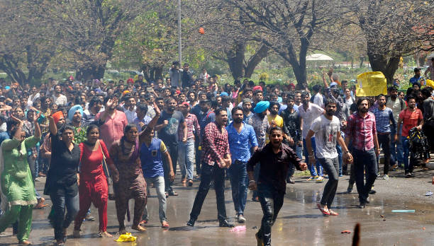 Students shout slogans during the allparty protest for fee hike outside VC office at Panjab University on April 11 2017 in Chandigarh India The fee...