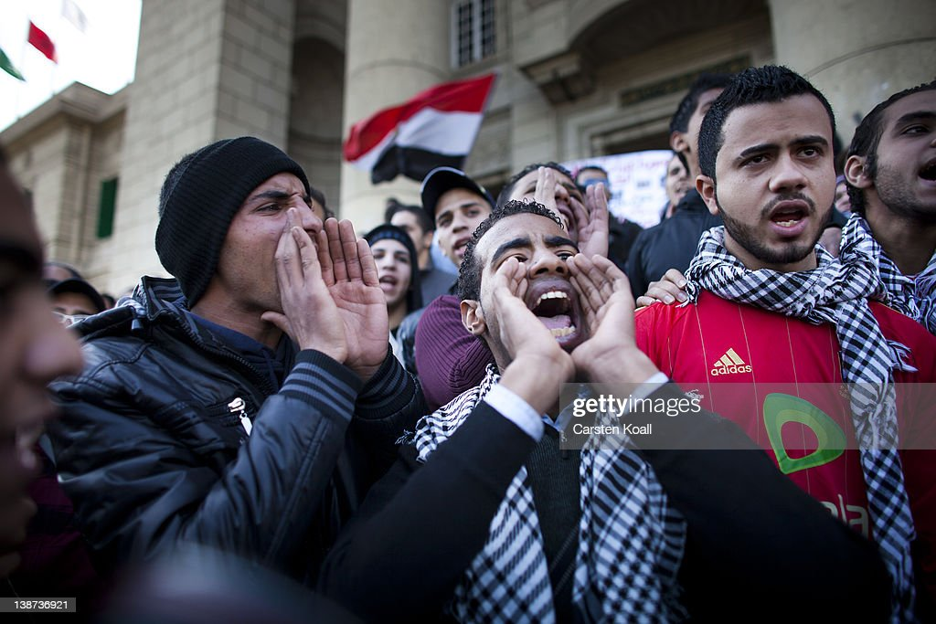 Students shout slogans in front of the Cairo University during a protest against the military rulers of the country on February 11, 2012 in Cairo, Egypt. Today is the first anniversary of the resignation of the former Muhammad Hosni Mubarak after his 30-year term on 11 February last year. The poor economic condition of the country and the unrest in the past are a threat to the transition to a democracy.