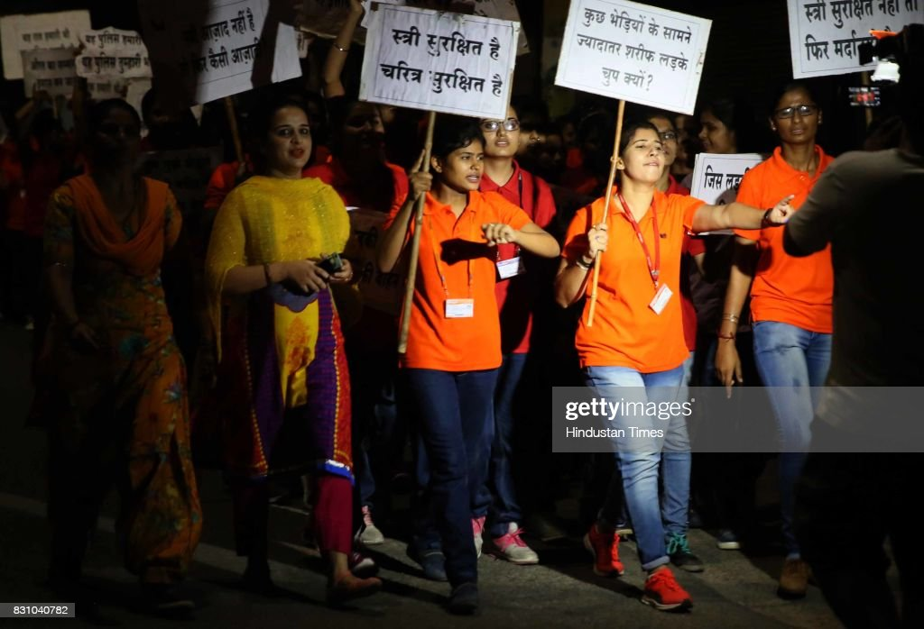 Students shout slogans 'Why most decent boys stay mum in face of few jackals' during the 'Meri Raat Meri Sadak' campaign in which thou