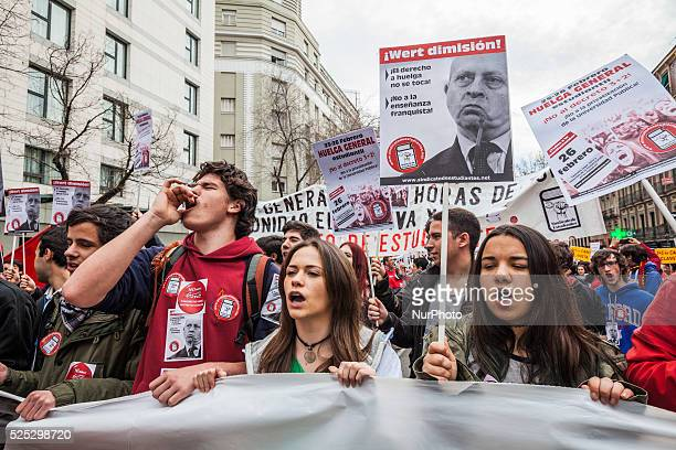 Students shout under a poster of the education minister Jose Ignacio Wert in the main front of the demonstration in Madrid against the privatization...