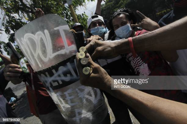 TOPSHOT Students show bullet casings during a protest against government's reforms in the Institute of Social Security in Managua on April 21 2018...