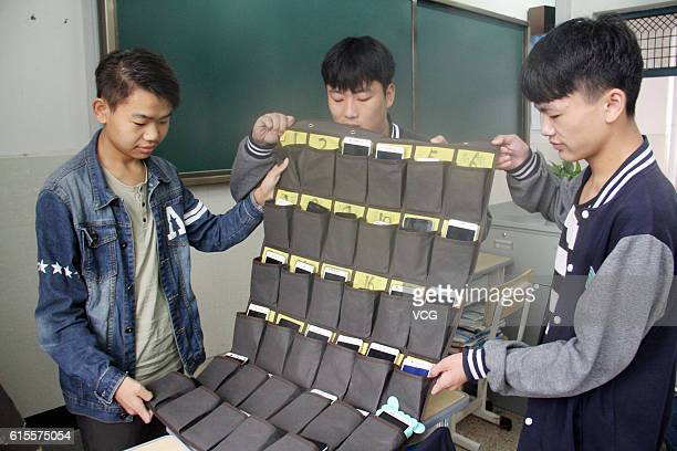 Students show the bag storing students' mobile phones in a vocational and technical school at Tonglu County on October 19 2016 in Hangzhou Zhejiang...