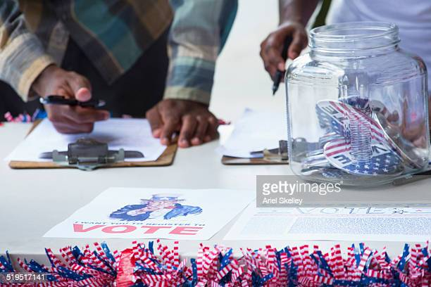 students signing up at voter registration - register stock photos and pictures