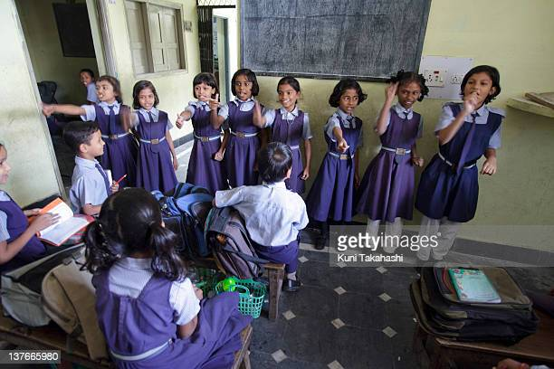 Students sing and dance at MA Idial High School a private school on November 24 2011 in Hyderabad India The government's recent passage of the Right...