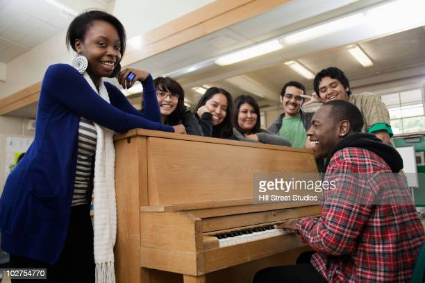 students singing in classroom - pianist front stock pictures, royalty-free photos & images