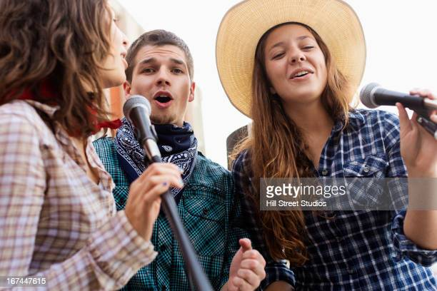 students singing together - countrymusik bildbanksfoton och bilder