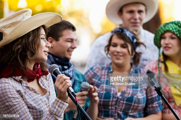 students singing together - country musik stock-fotos und bilder