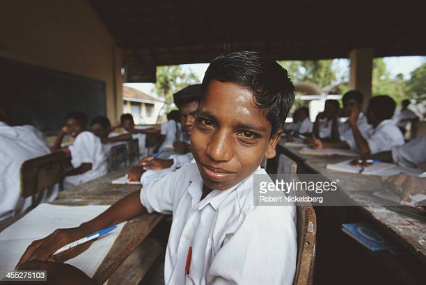 Students sit at their desks at a school in LTTE controlled Kokkadichcholai Sri Lanka circa 1995