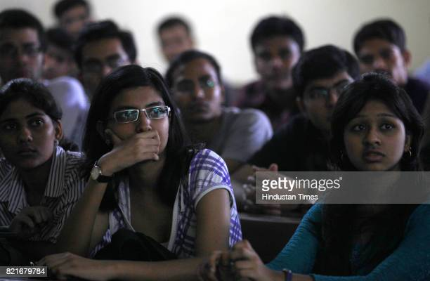 Students sit inside a classroom of Government Law College in Mumbai on Friday