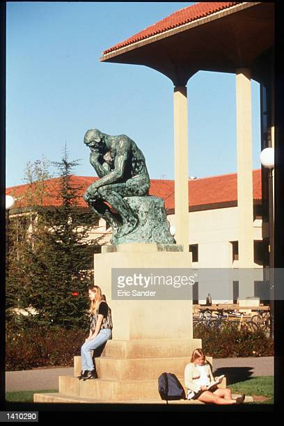 Students sit near a statue on the campus of Stanford University March 15, 1997 in San Francisco, CA. Since the beginning of the 1990s San Francisco...