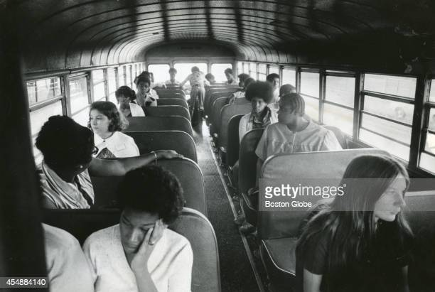Students sit on a bus going from Columbia Point to Roxbury High School on Sept 13 the second day of school under the new busing system put in place...