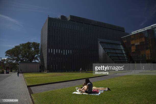 Students sit on the grass at the University of Sydney in Sydney, Australia, on Tuesday, Feb. 25, 2020. The coronavirus hit has exposed the...