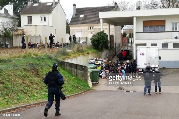 Students sit on the ground after being arrested by police in the garden of a pavilion and an associated house close at the SaintExupery high school...