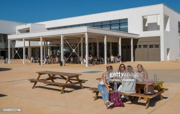 Students sit outdoors during lunch break at NOVA School of Business and Economics new campus on October 04 2018 in Carcavelos Portugal Nova SBE is a...
