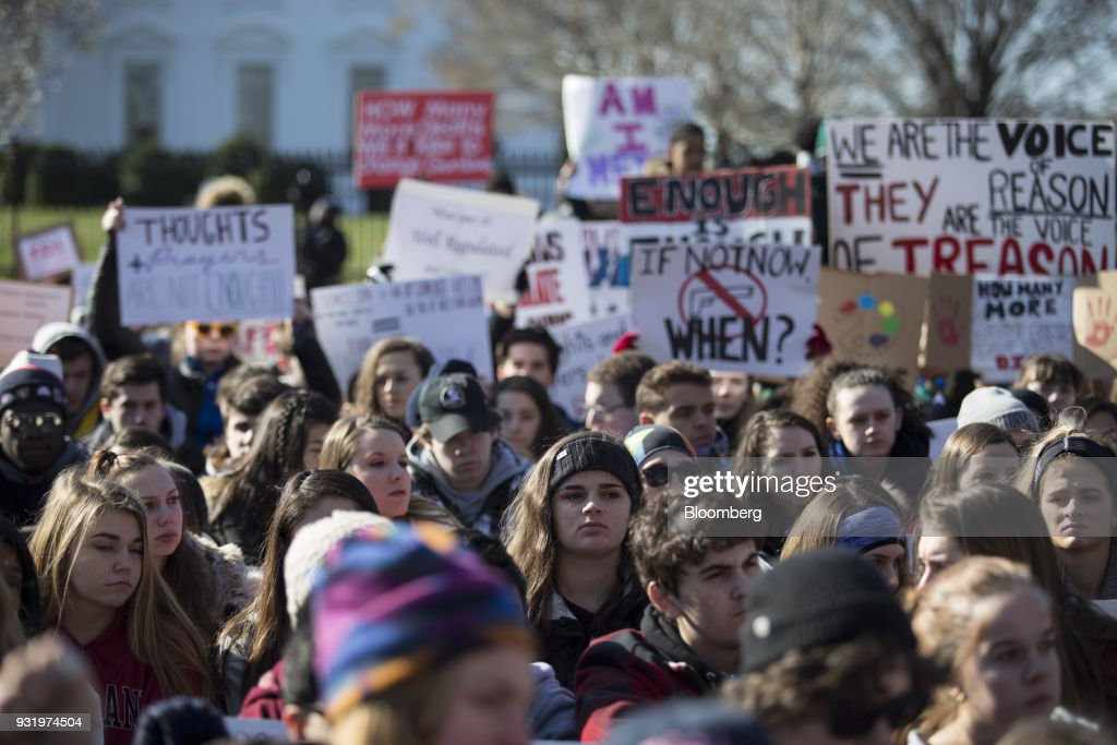 Students sit outside the White House during the