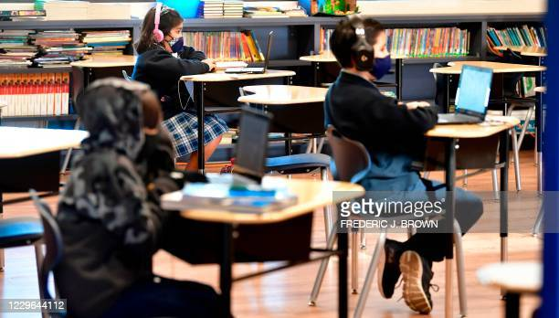 Students sit with their laptop computers at St. Joseph Catholic School in La Puente, California on November 16 where pre-kindergarten to Second Grade...