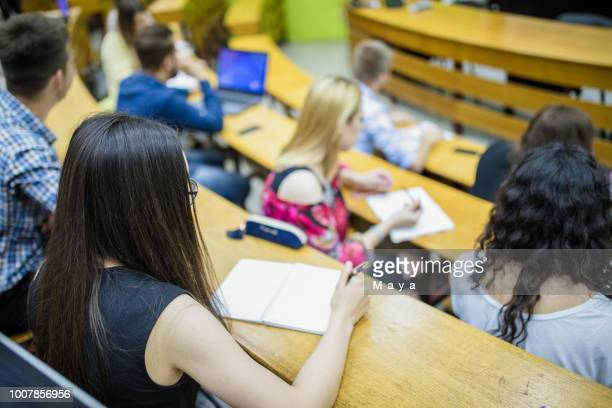 students sitting in amphitheater - amphitheatre stock pictures, royalty-free photos & images