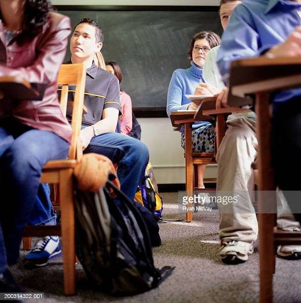 Students sitting in lesson, in classroom, low angle view