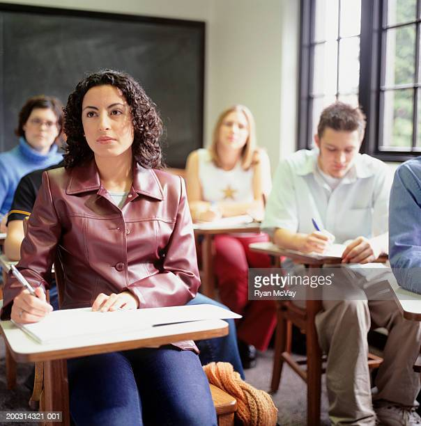 Students sitting in lesson, in classroom