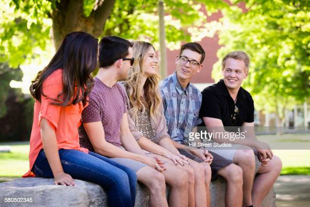 Students sitting on college campus