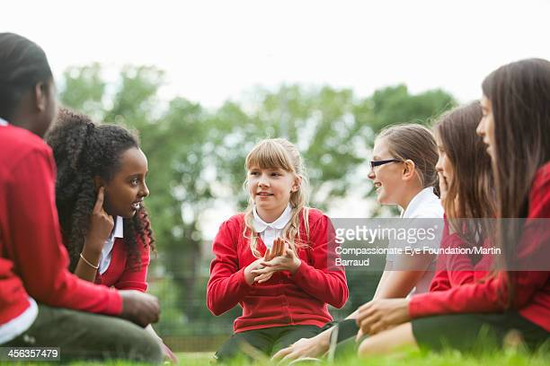 Students sitting on grass relaxing